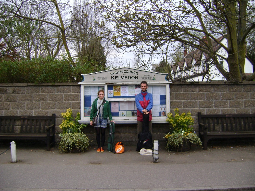 Barbara Bartz and Robin Grey by the village noticeboard in Kelvedon